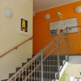 The stair case to the kindergarten is decorated with children's paintings