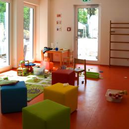 The kid's play room has a soft floor